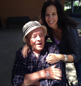 Dori Ekstein poses with her late father, a Holocaust survivor who was imprisioned at Auschwitz concentration camp.