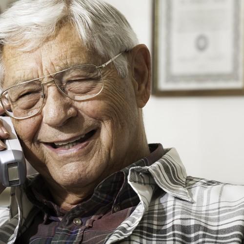 Senior man talking on telephone