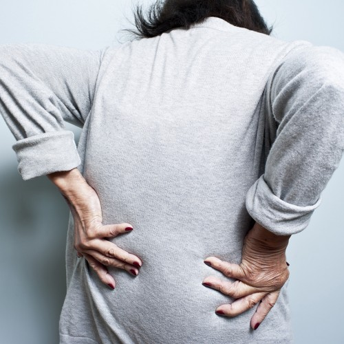 Elderly woman with bad back ache