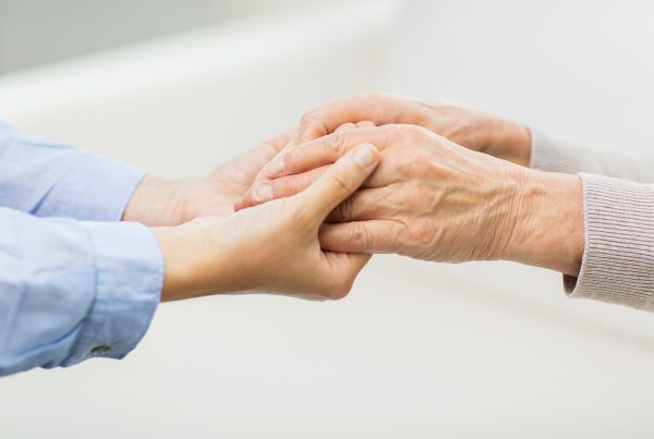 close up image of young and old hands