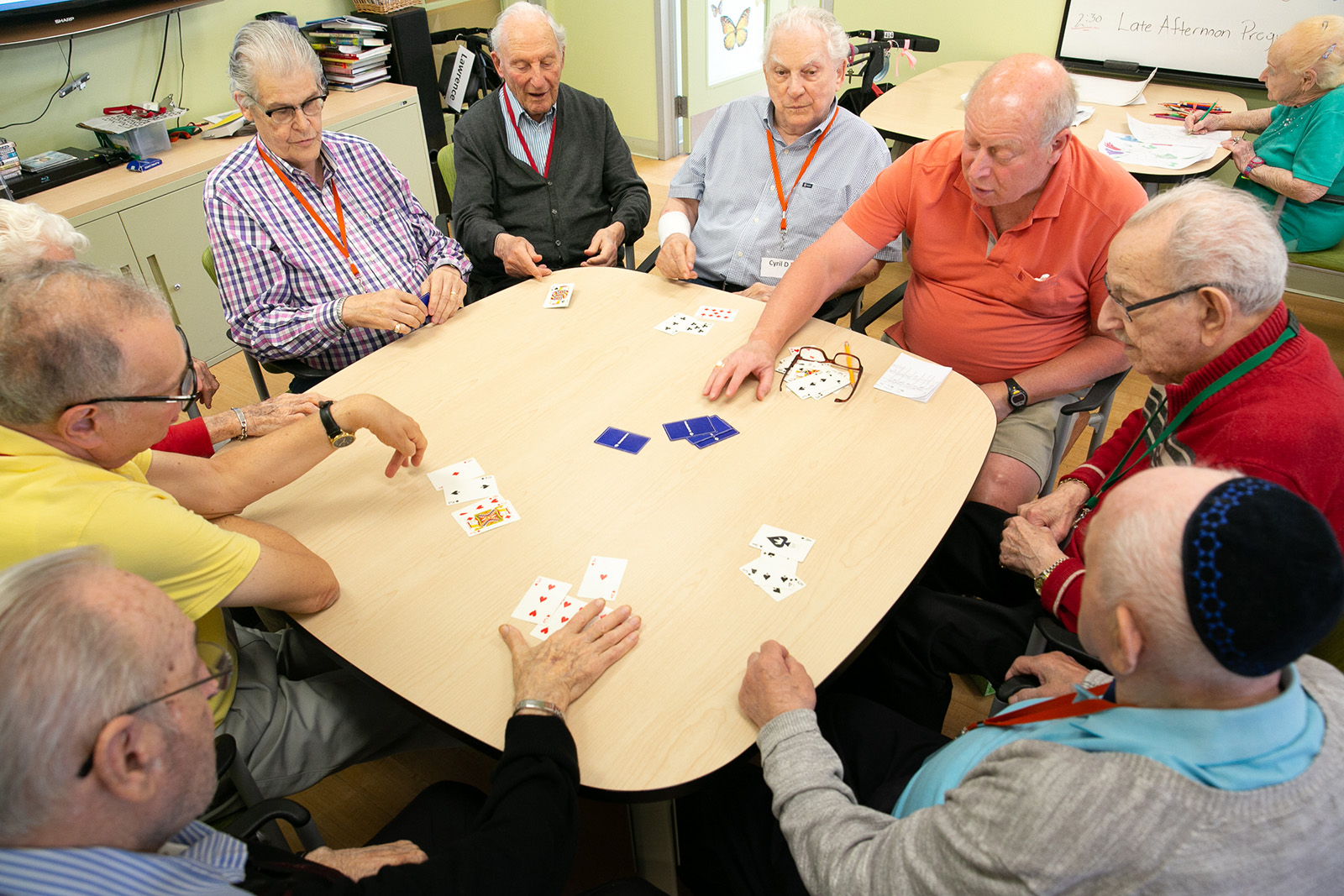 photo of Ed playing cards with Adult Day Program clients