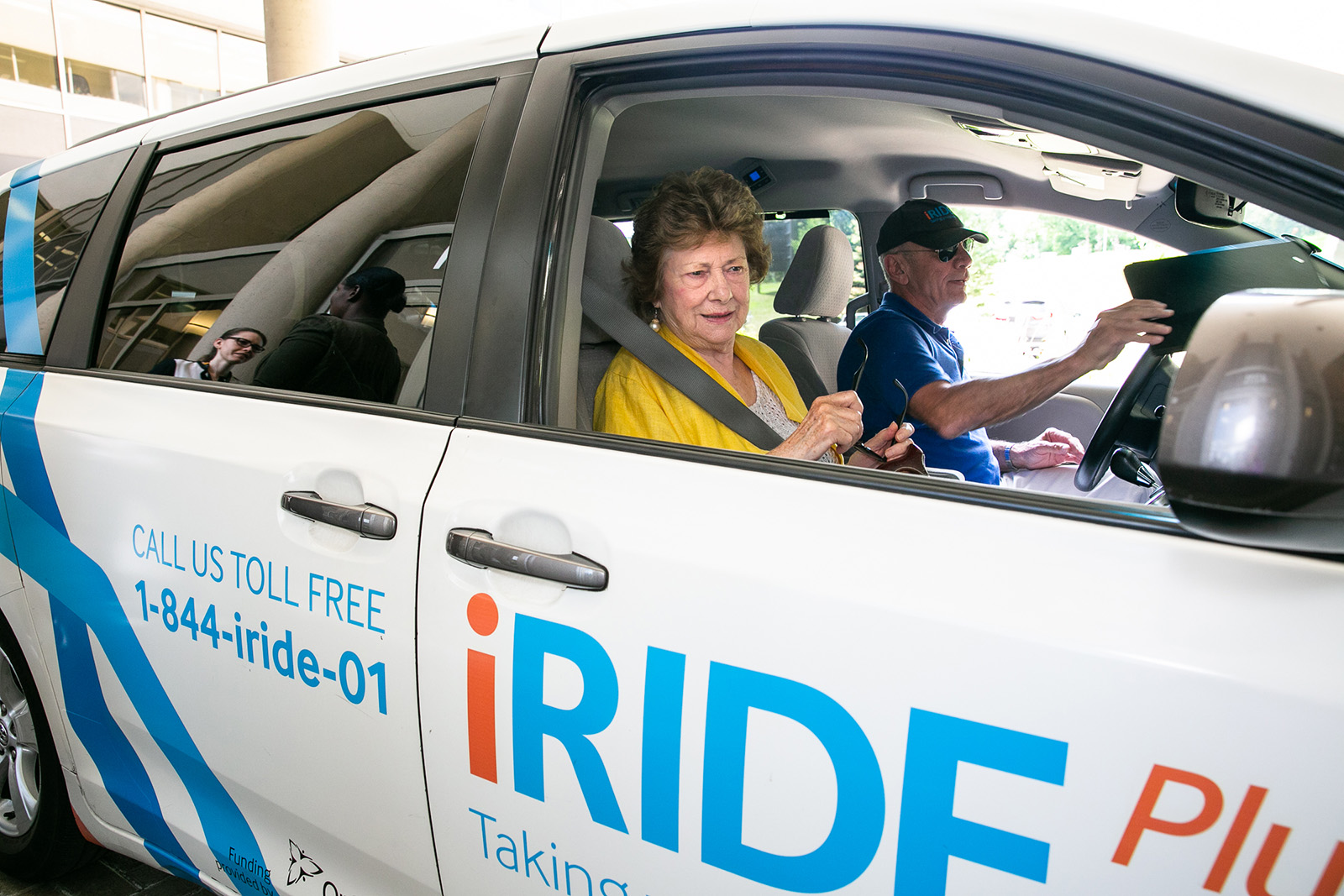 photo of client and iRIDE driver