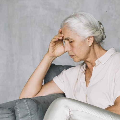Elderly woman looking depressed