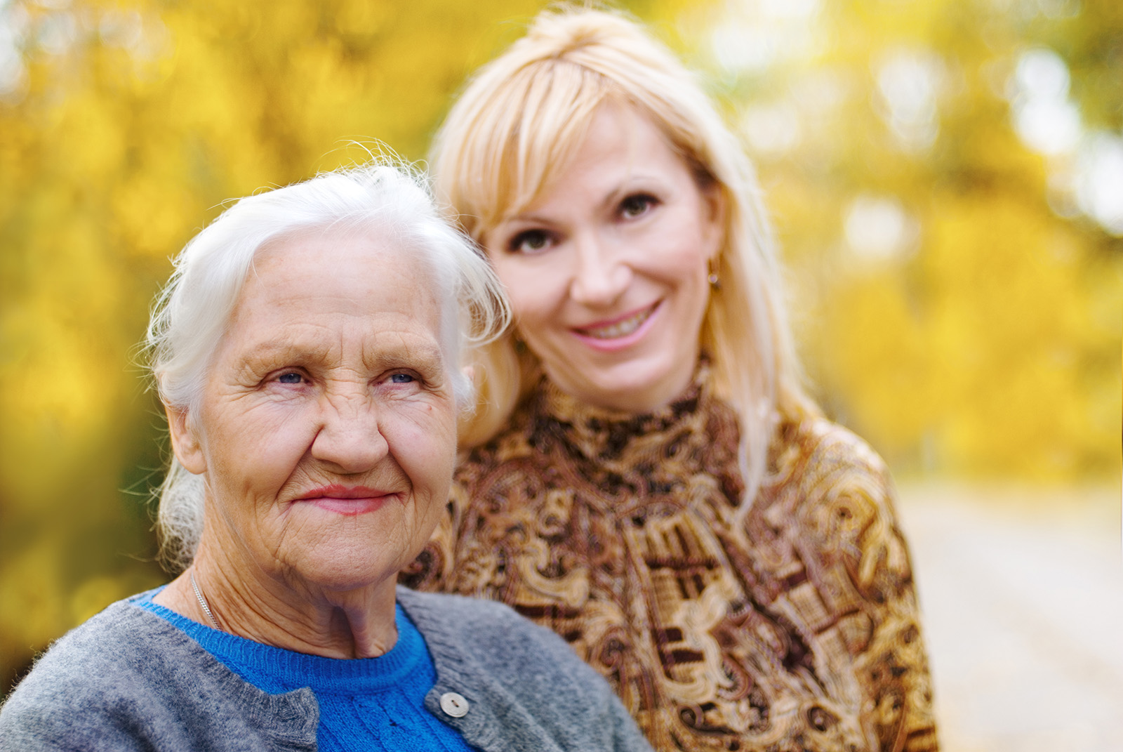 Elderly woman with younger woman in the background
