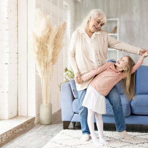 Elderly grandmother playing with granddaughter