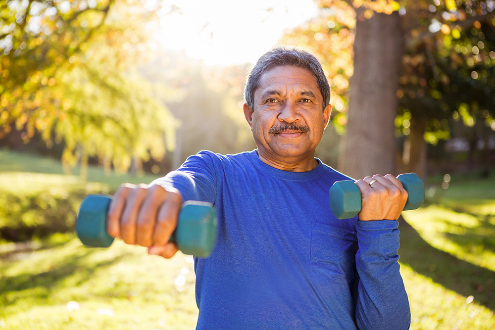 Older man exercising with dumbbells