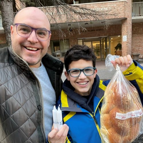Asher Lichtman and his son deliver challah and candles to Jewish clients.